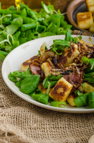 Stock photo: Potato gnocchi with salad and onions
