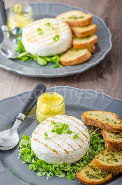 Grilled camembert with herbs, baquettes Stock photo © Peteer
