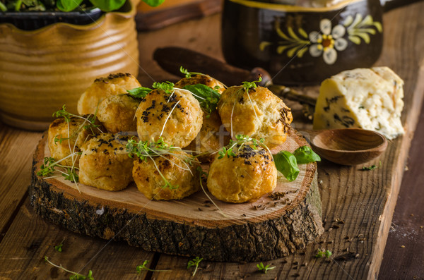 Cheesy bites with blue cheese and pepper Stock photo © Peteer
