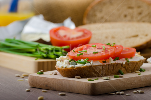 Healthy breakfast - homemade beer bread with cheese, tomatoes and chives Stock photo © Peteer