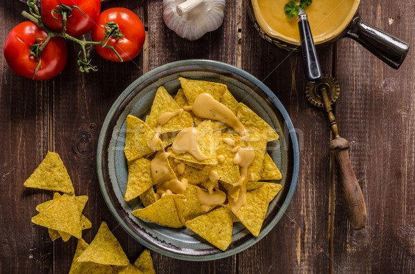 Nachos with homemade cheese dip Stock photo © Peteer