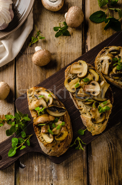 Stock photo: Rustic Toast bread with garlic, mushrooms and herbs