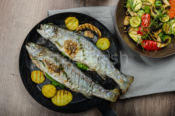 Grilled Trout with Mediterranean vegetables Stock photo © Peteer