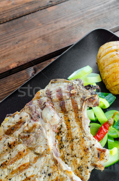 Grilled cutlet with vegetables and roasted potatoes Stock photo © Peteer