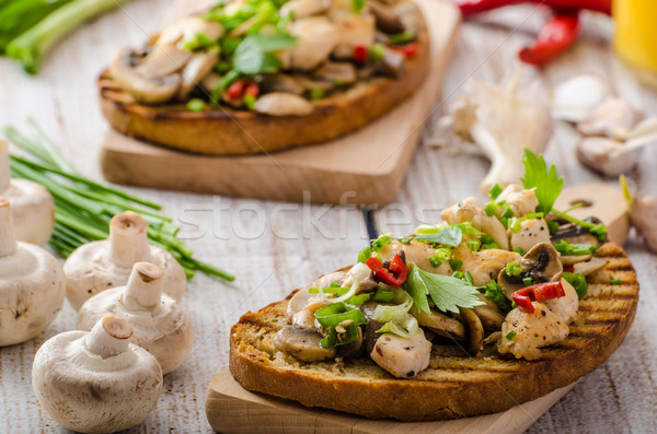 Stock photo: Toast with mushrooms and fried chicken, sprinkled with Toast with mushrooms and fried chicken