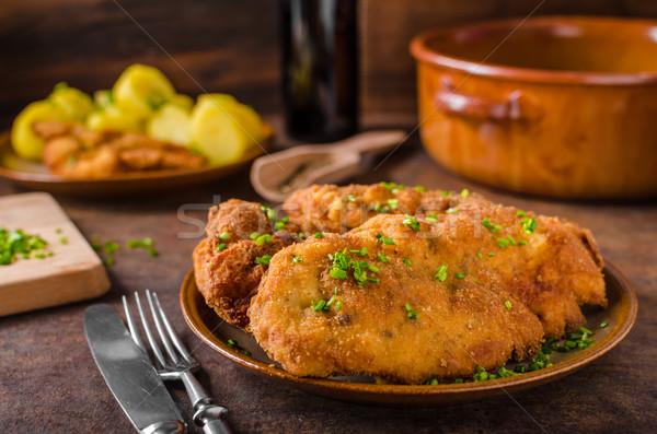 Wiener schnitzel with potatoes Stock photo © Peteer