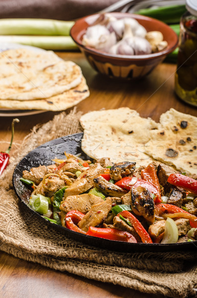 Sichuan meat mix with naan Stock photo © Peteer