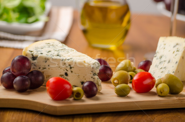 Delicious blue cheese with olives, grapes and salad Stock photo © Peteer