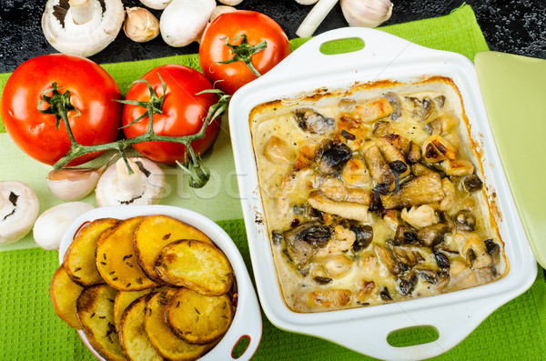 Baked chicken with mushrooms and cream Stock photo © Peteer
