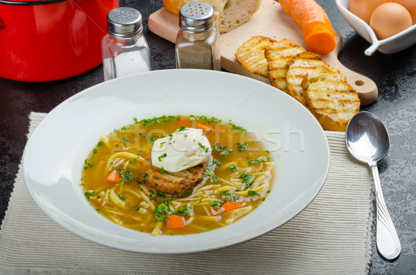 Beef broth with toast and egg benedict Stock photo © Peteer
