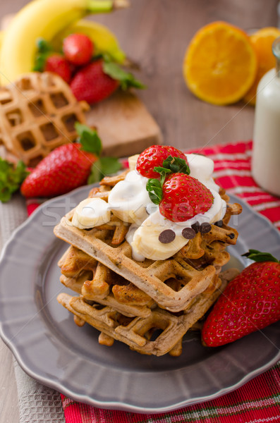 Belgian waffles with chocolate chips and fruits Stock photo © Peteer