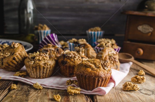 Stock photo: Whole grain muffins with dark chocolate and nuts