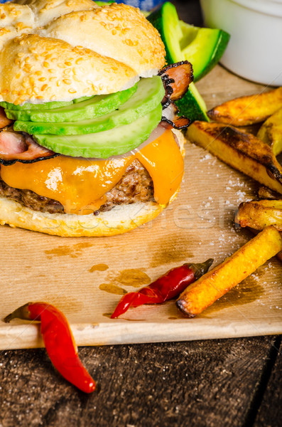 Homemade avocado burger with home spicy fries Stock photo © Peteer