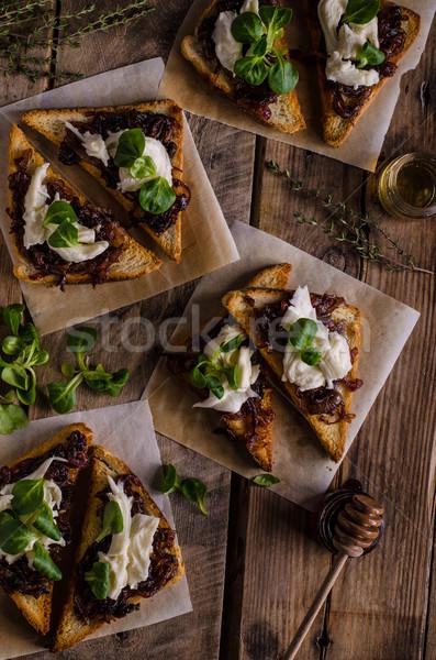 деревенский тоста лука Сыр из козьего молока чеснока травы Сток-фото © Peteer