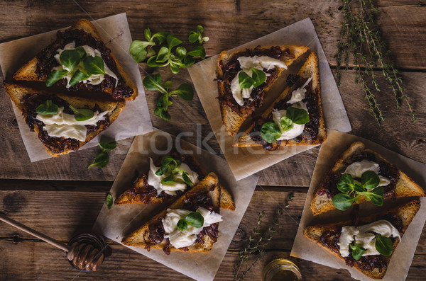 Rustic toast with caramelized onion and goat cheese Stock photo © Peteer