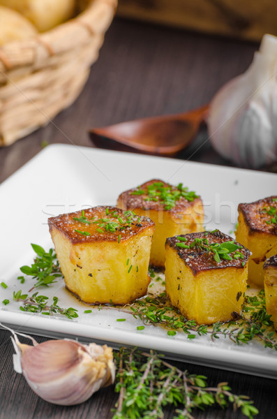 Potato fondant with garlic and herbs Stock photo © Peteer