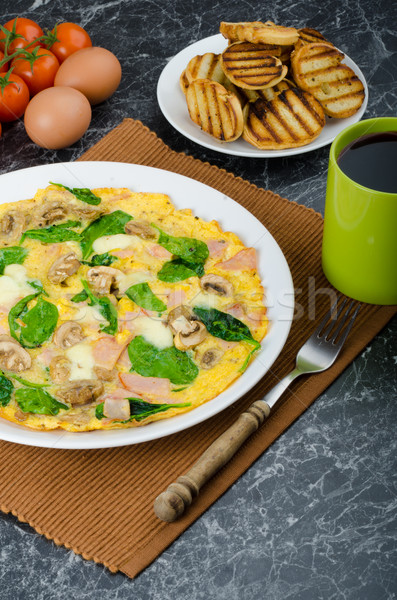 Frittata with ham, mushrooms and spinach Stock photo © Peteer
