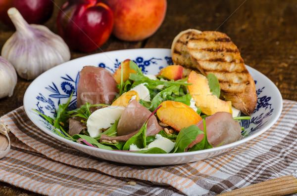 Cohete ensalada prosciutto frutas mozzarella duraznos Foto stock © Peteer