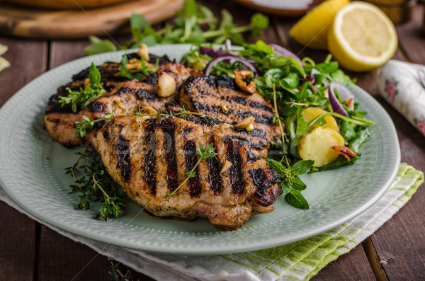 Grilled pork chops with lettuce salad Stock photo © Peteer
