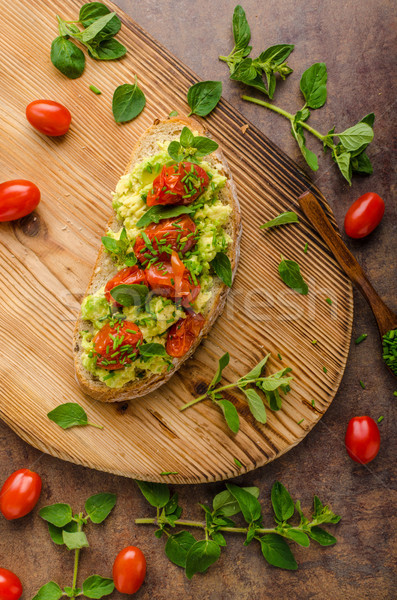 Avocado spread with tomatoes Stock photo © Peteer