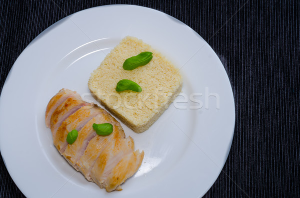 Grilled chicken breast with couscous and basil Stock photo © Peteer
