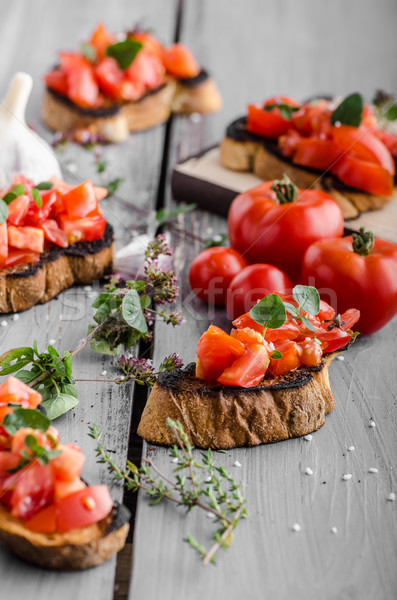 Bruschetta with tomatoes, garlic and herbs Stock photo © Peteer