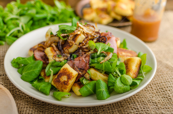 Potato gnocchi with salad and onions Stock photo © Peteer