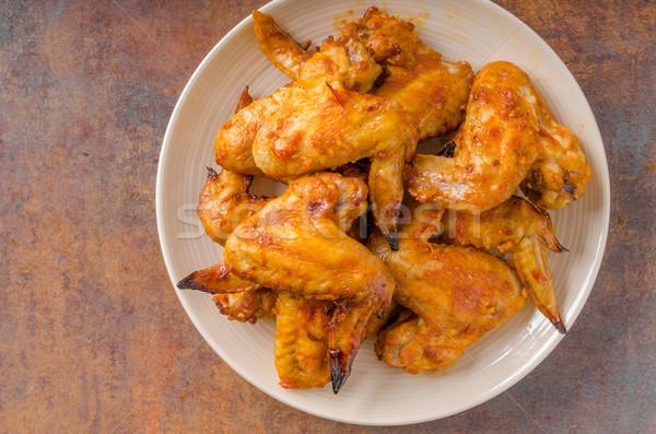 Gegrilde kip vleugels heerlijk knoflook saus achtergrond Stockfoto © Peteer