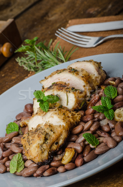 Roasted chicken breast with herbs and stewed beans Stock photo © Peteer