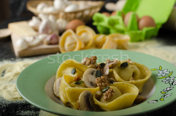 Pasta of the Italian semolina flour - Tortellini Stock photo © Peteer