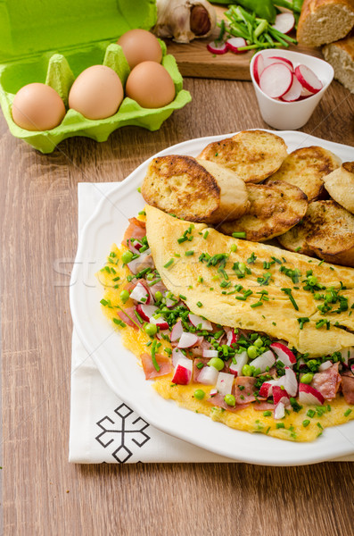 Omelette with spring vegetables and bacon Stock photo © Peteer