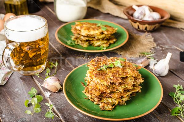 ストックフォト: ジャガイモ · パンケーキ · ニンニク · ビール · ハーブ