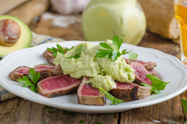 Beef steak with avocado dip and herbs Stock photo © Peteer