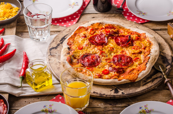 Rustic salami pizza with chorizo Stock photo © Peteer