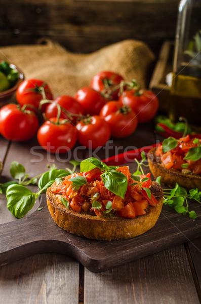 Olasz bruschetta pörkölt paradicsomok fokhagyma gyógynövények Stock fotó © Peteer