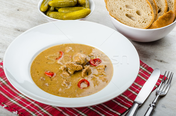 Pork stew and homemade bread and pickles Stock photo © Peteer