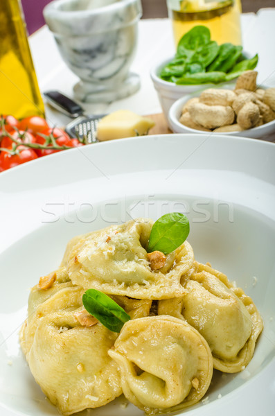 Homemade tortellini stuffed with spinach and garlic Stock photo © Peteer