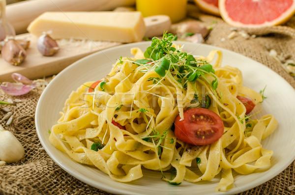 Semolina pasta with roasted garlic, sprinkled microherbs Stock photo © Peteer