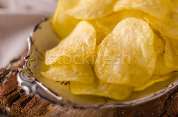 Potato chips product photography Stock photo © Peteer