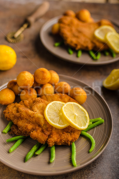 Wiener schnitzel with croquettes Stock photo © Peteer