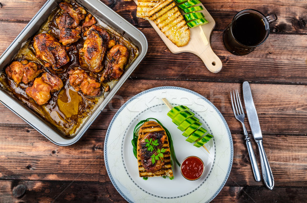 Sticky chicken with spicy sauce, toasted panini Stock photo © Peteer
