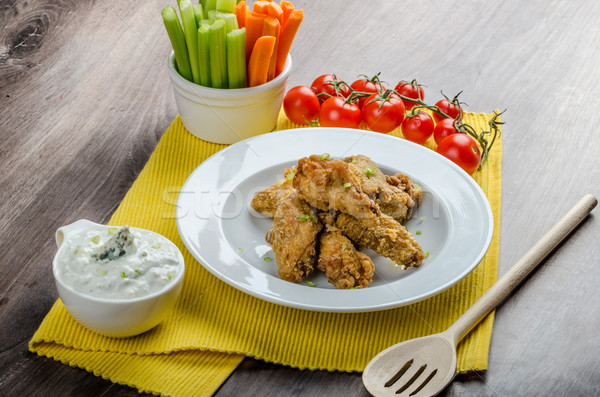 Crispy chicken wings Stock photo © Peteer