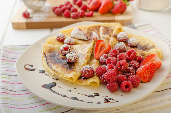 Pancakes with homemade balsamic reduction and fresh fruit Stock photo © Peteer