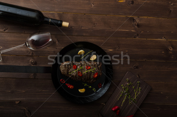 Beef steak with herbs and chilli, product photo Stock photo © Peteer