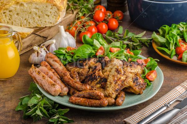 Pollo a la parrilla alas salchichas parrilla temporada alimentos Foto stock © Peteer