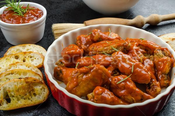 Hot chicken wings, habanero souce, salad Stock photo © Peteer