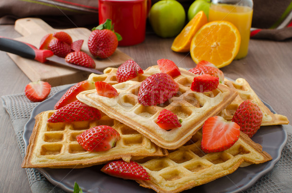 Homemade waffles with maple syrup and strawberries Stock photo © Peteer