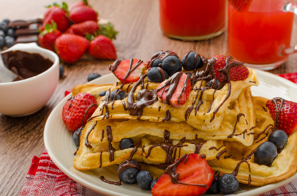 Belgian waffles with blueberries, strawberries Stock photo © Peteer