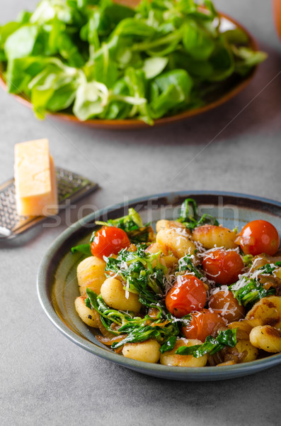 Gnocchi with spinach, garlic and tomatoes Stock photo © Peteer