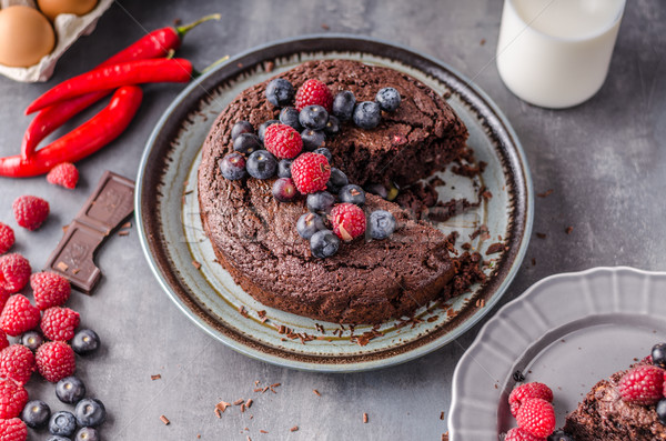 Brownies cake with chilli and berrries Stock photo © Peteer